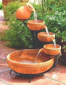 cascading water flowing down a series of terracotta pots