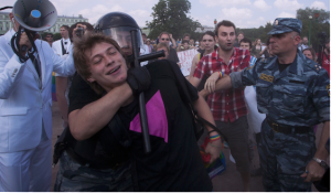 A pro-LGBT protestor is detained by police forces at a recent rally in St. Petersburg, Russia.